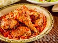 Рецепта Пилешки бутчета с доматена салца печени на фурна